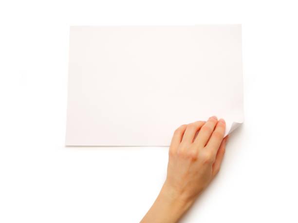 Main de femme retournement de papier - Photo