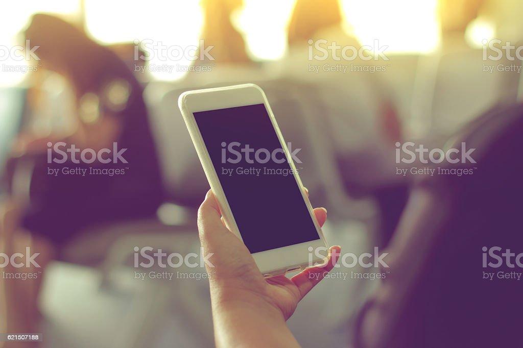 Woman's hand Using a Smart Phone photo libre de droits
