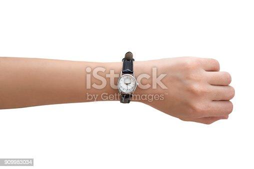 istock Woman's Hand Wearing Wrist Watch 909983034