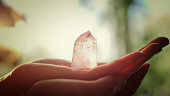 Healing crystal. Healing crystal on of palm of her hand. This crystal is an Citrine stone.