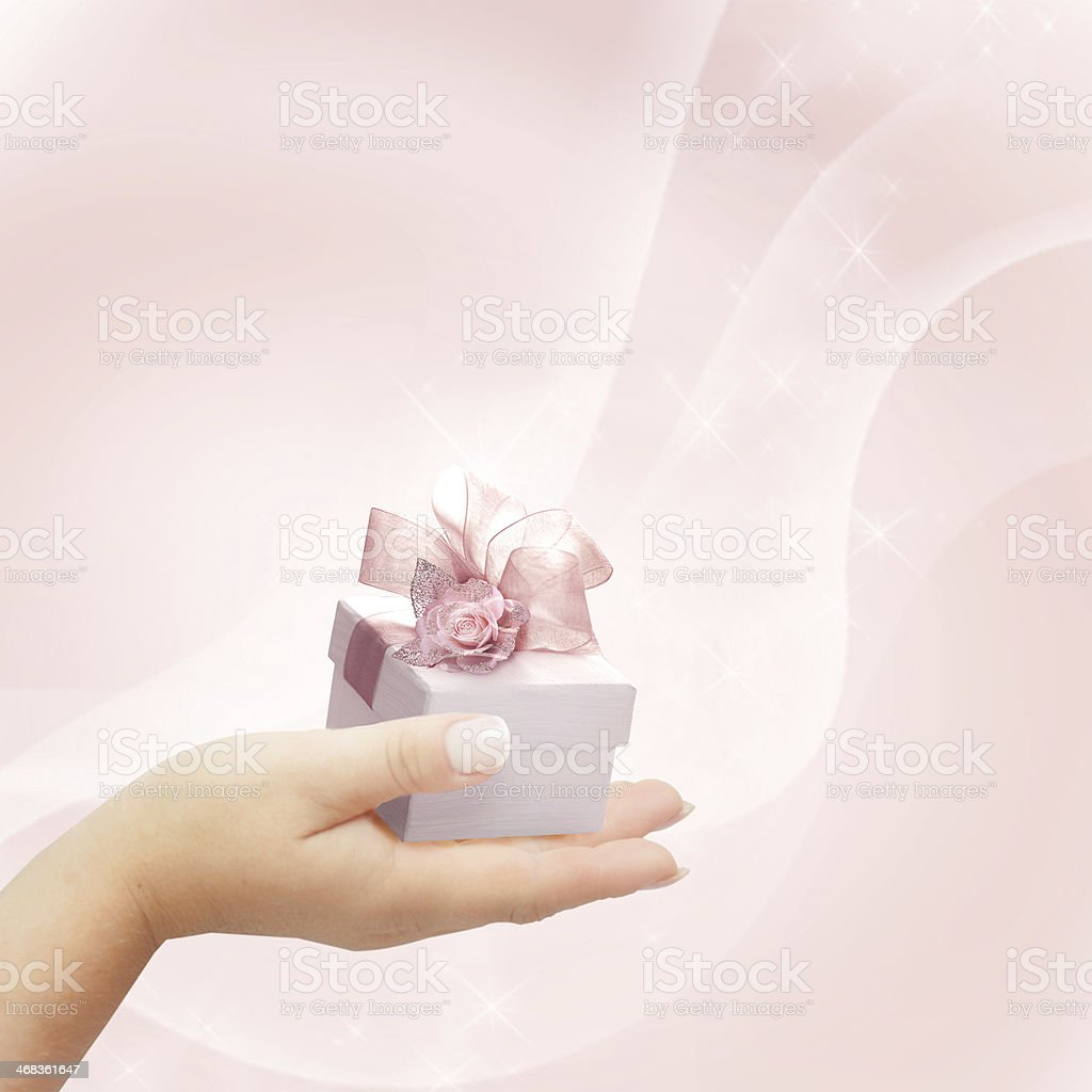 Woman's hand with a small gift box. royalty-free stock photo