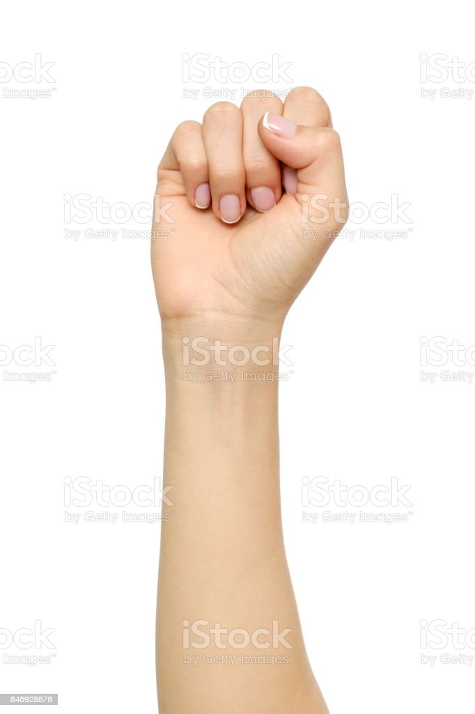 Woman's hand with fist gesture isolated on white stock photo