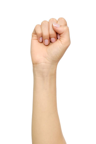 woman's hand with fist gesture isolated on white - fist stock photos and pictures