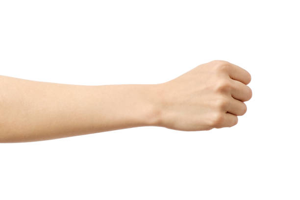 woman's hand with fist gesture isolated on white - afferrare foto e immagini stock