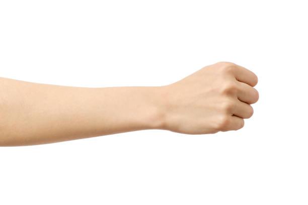 白で隔離拳ジェスチャーで女性の手 - 手 女性 ストックフォトと画像