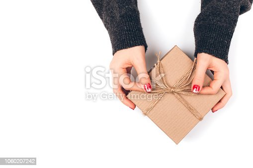 istock Woman's hand with gift box 1060207242