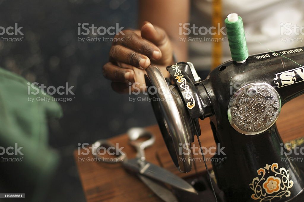 Woman's Hand with Old-Style Manual Sewing Machine stock photo