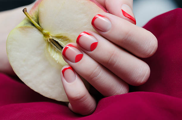 Woman's hand with red french manicure. stock photo