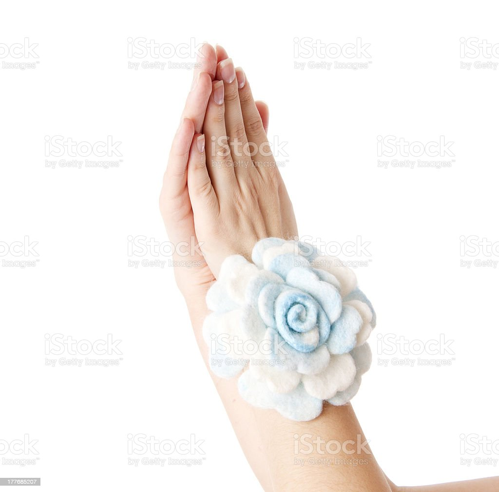Woman's hand with the decoration of wool royalty-free stock photo