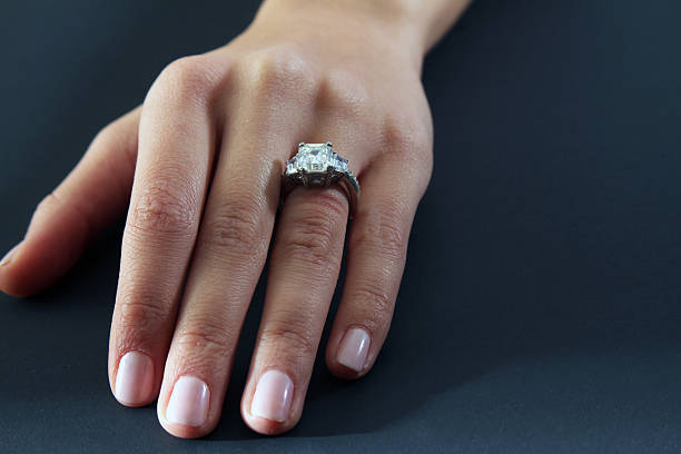 woman's hand with wedding ring - diamond ring hand stock photos and pictures