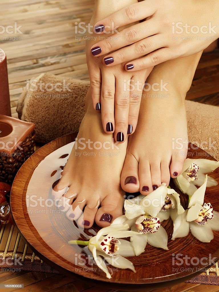 Woman's hands and feet after a manicure and pedicure at dos stock photo