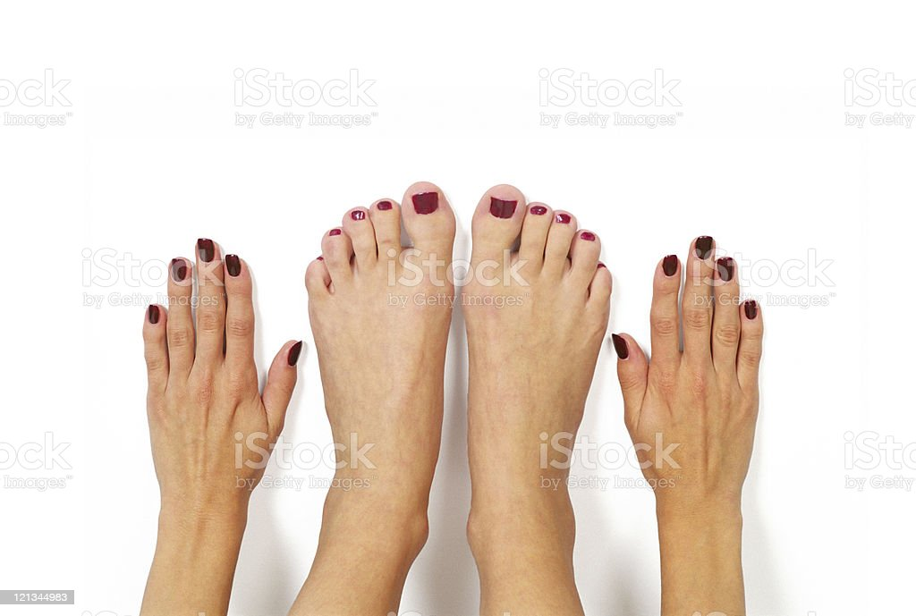 Woman's hands and feet, manicure, pedicure royalty-free stock photo