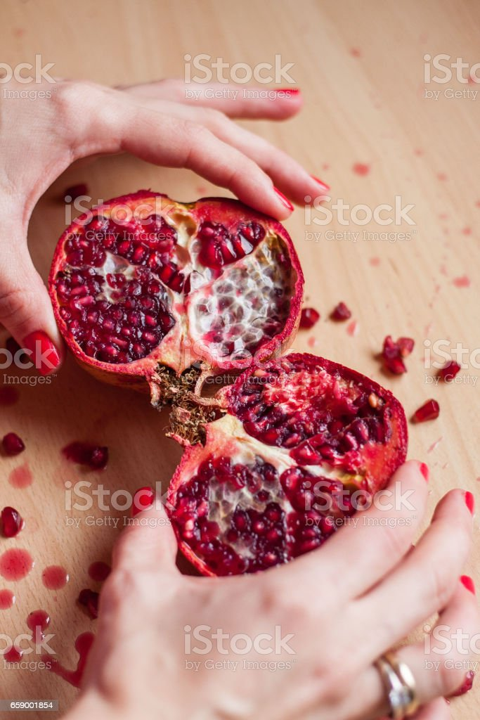 Womans hands and pomegranate royalty-free stock photo