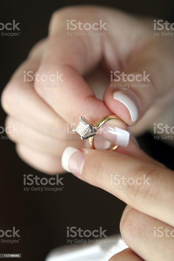 womans hands bride holding diamond wedding engagement ring royalty-free stock photo