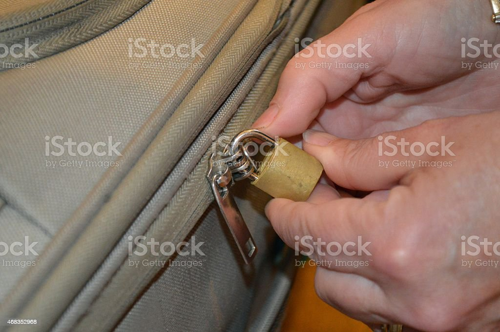Womans hands closing a lock royalty-free stock photo