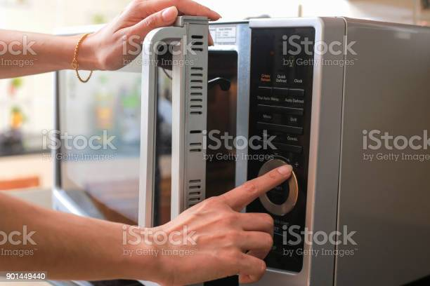 Womans hands closing microwave oven door and preparing food in picture id901449440?b=1&k=6&m=901449440&s=612x612&h=b5r03hwj8r0dtr44m6lkohzndko52gfzmfes6cpmjlo=