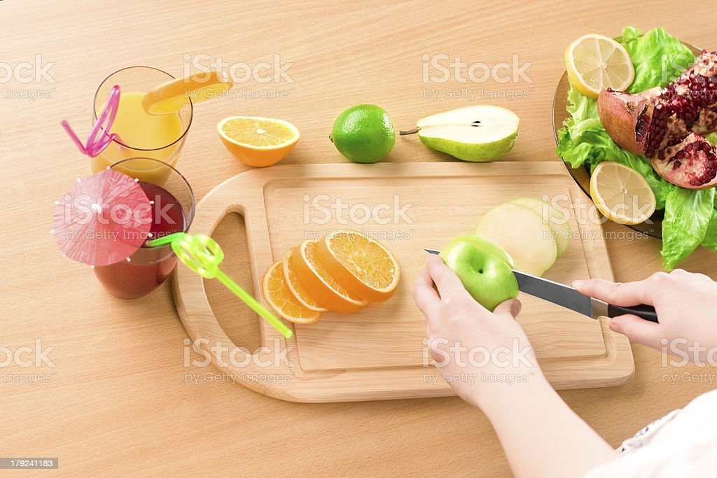Woman's hands  cutting apple royalty-free stock photo