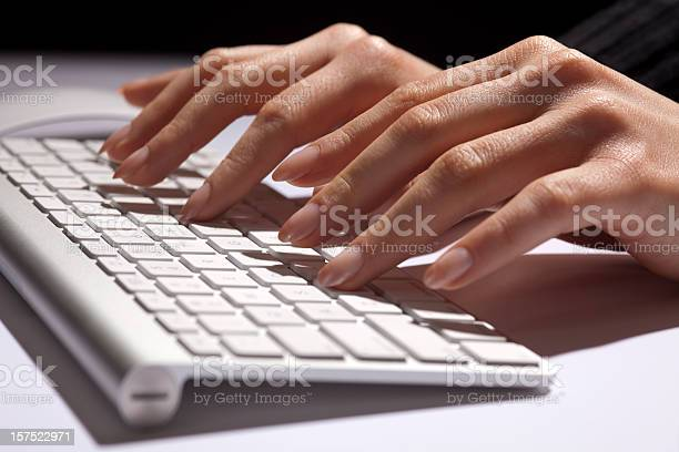 Woman's Hands Fingers Typing, Data Entry, Modern White Aluminum Keyboard  Administrator Stock Photo