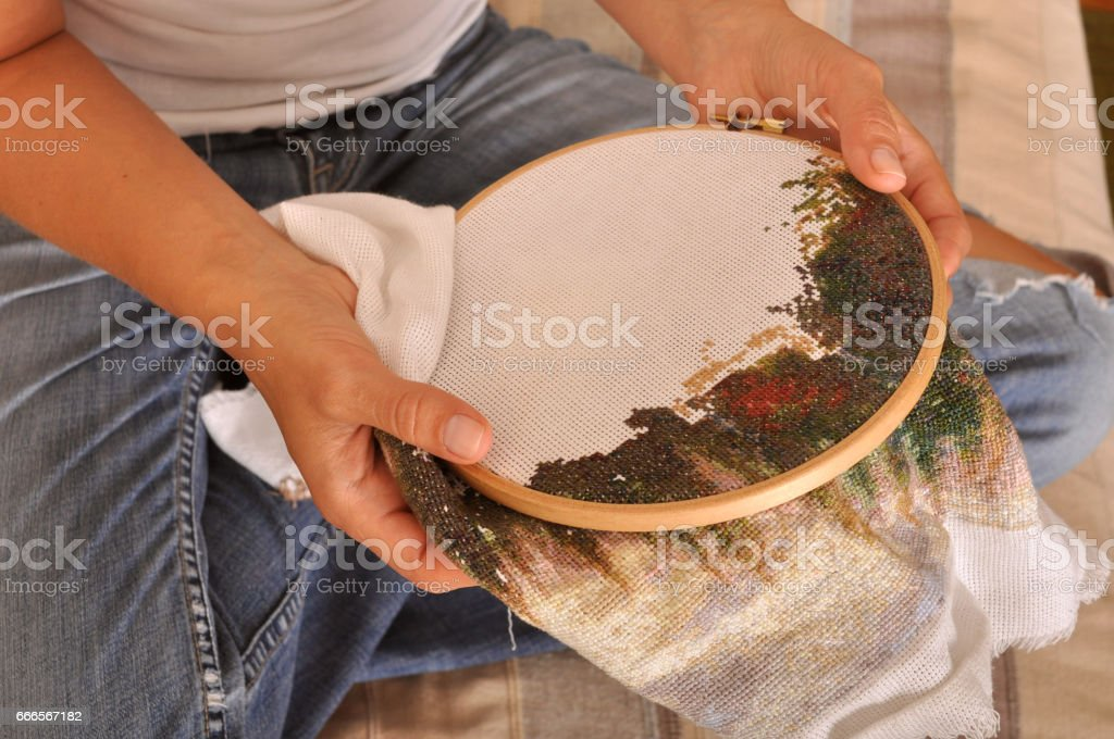 Womans Hands Hold The Embroidery Frame With Embroidery Stock Photo