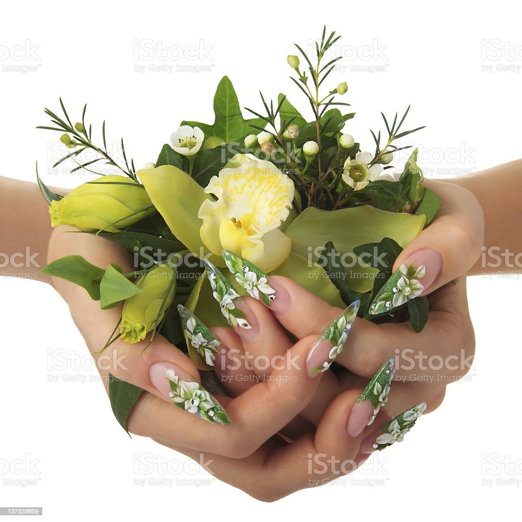 Woman's hands holding a bouquet of flowers. royalty-free stock photo