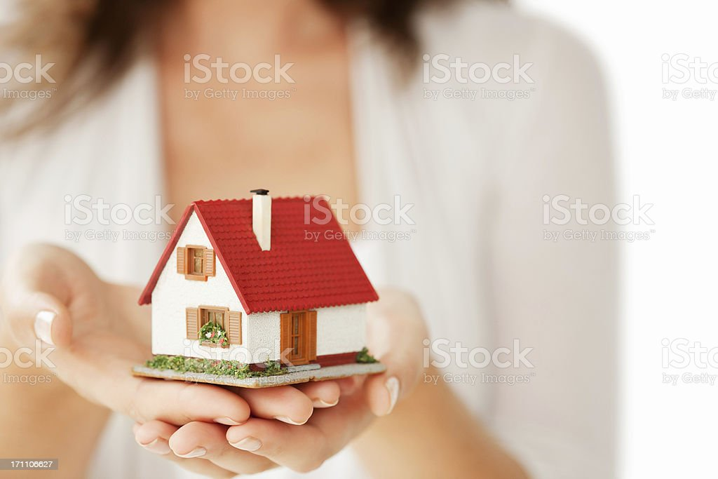 Woman's Hands Holding a Little House - Isolated stock photo