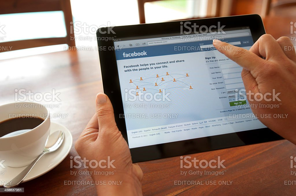 Womans hands holding an Apple iPad stock photo