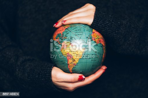 Woman's hands holding Earth. Ecology and saving planet concept.