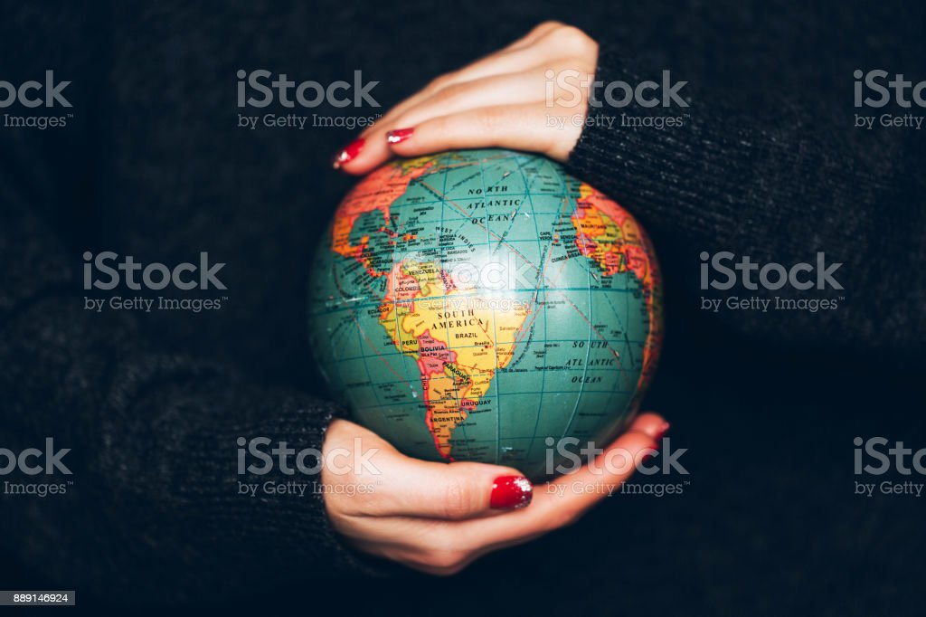 Woman's hands holding Earth. stock photo