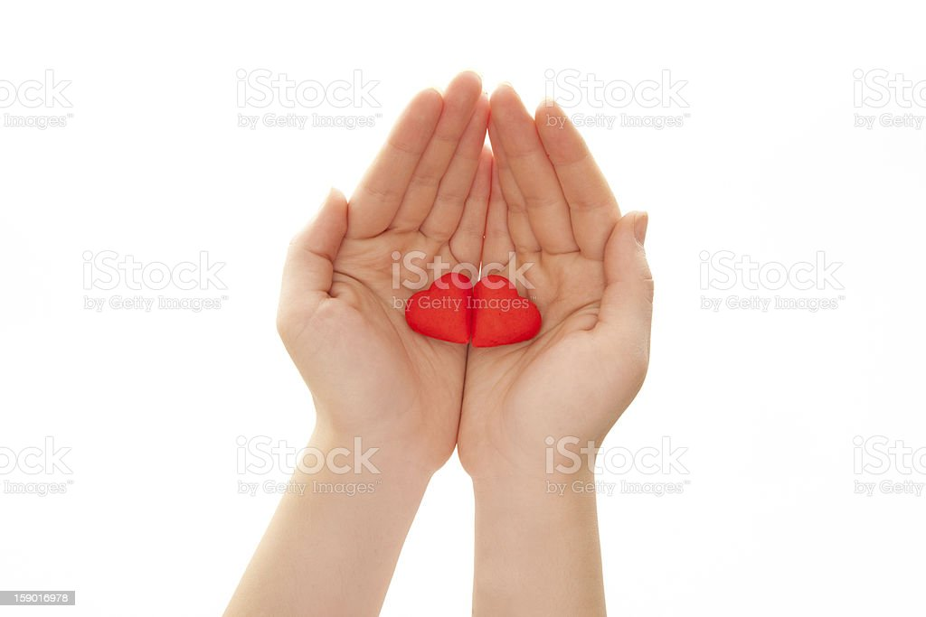 Woman's hands holding heart-shaped cookies royalty-free stock photo