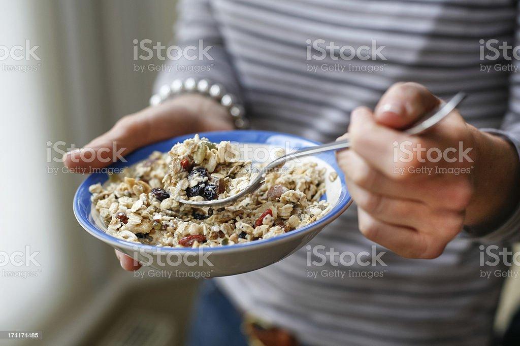 woman's hands holding muesli stock photo