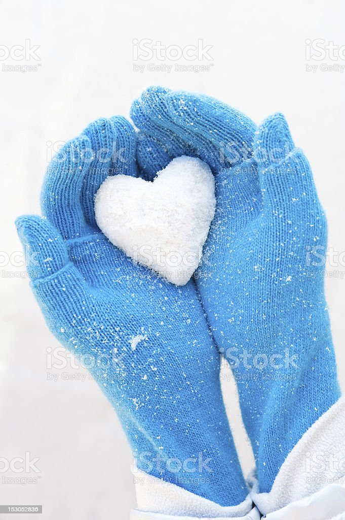 Woman's hands holding snowheart stock photo