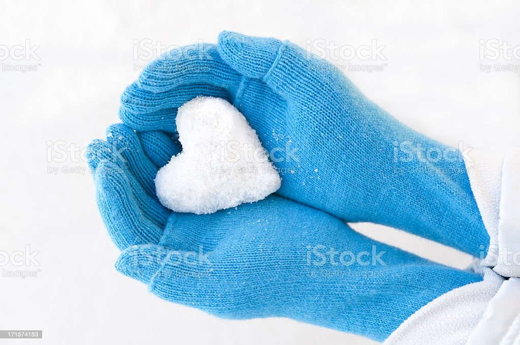 Woman's hands holding snowheart. royalty-free stock photo