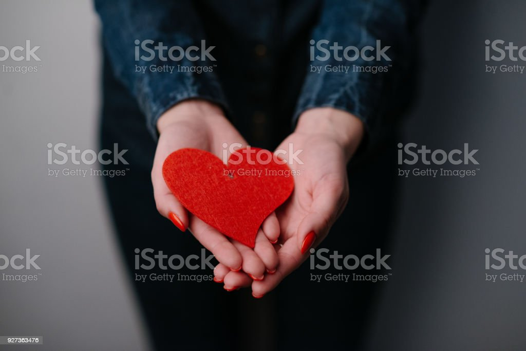 Woman's hands holding sweet red heart. Close up. - Royalty-free Adult Stock Photo