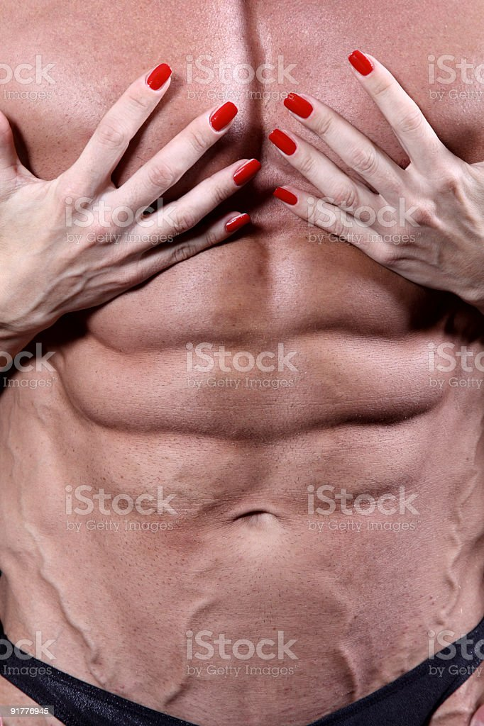 Woman's hands on a sexy man's torso royalty-free stock photo
