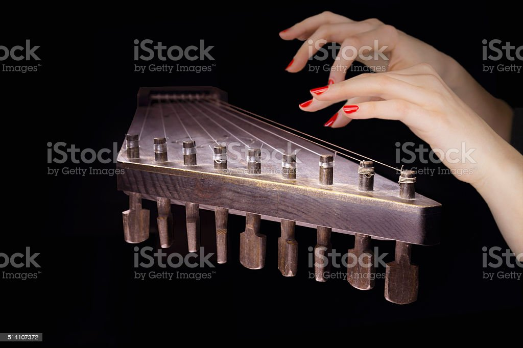 Woman's hands on a zither stock photo