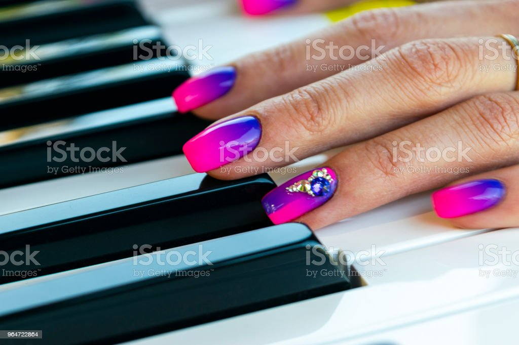 Woman's hands on the keyboard of the piano closeup. Hands musician playing the piano. Top view. Hands pianist playing music on the piano. Musical education concept. royalty-free stock photo