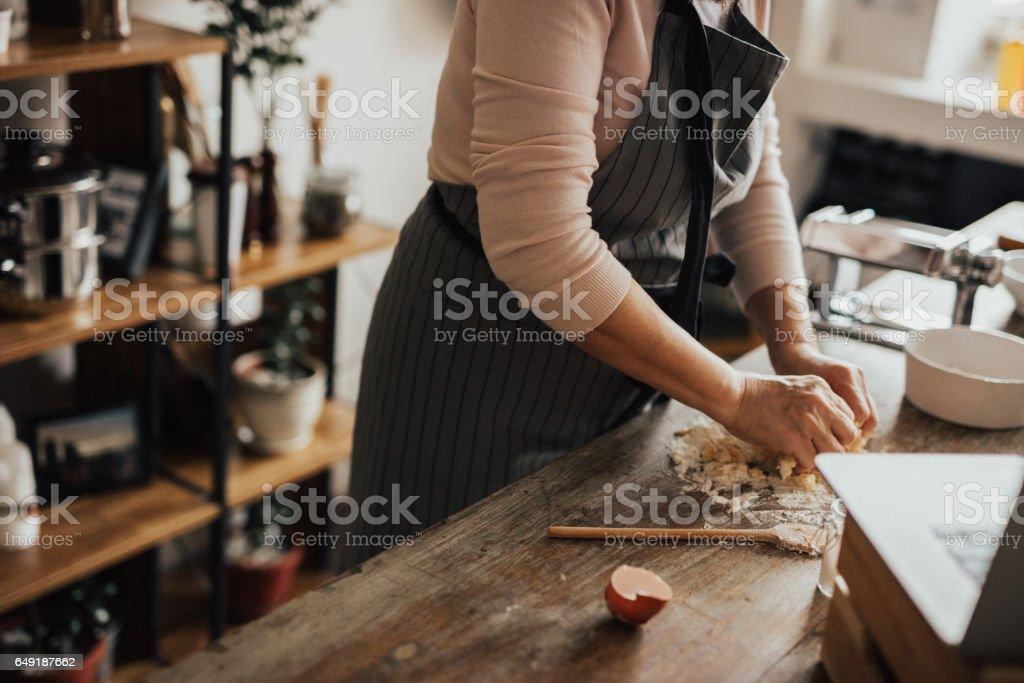 Woman's hands preparing dough stock photo