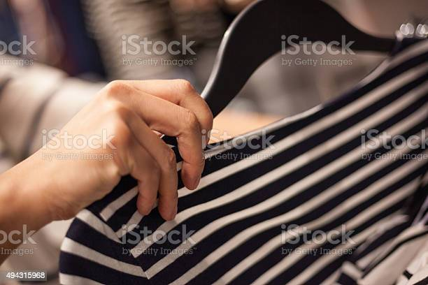 Womans hands selecting cloths in fashion store picture id494315968?b=1&k=6&m=494315968&s=612x612&h=zsr8zqx0v5oazecrz3q5p6kbawbkr2w6omlzcsyz4fw=