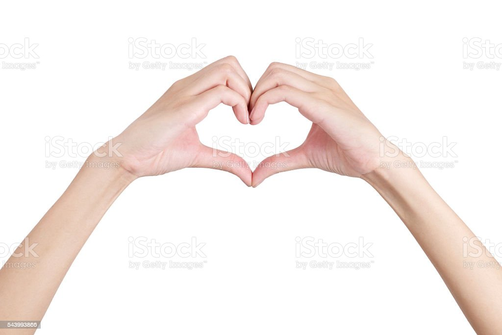 Woman's hands shaping a heart symbol with front side. stock photo