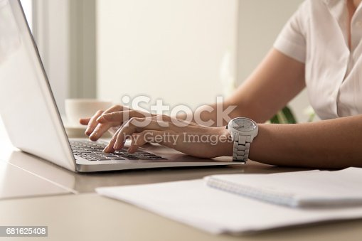 istock Womans hands typing on laptop at workplace 681625408