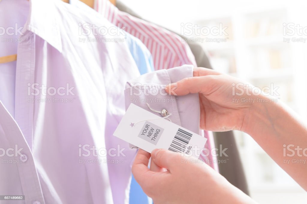 Woman's hands with a barcode label stock photo