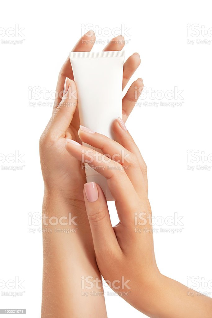 Woman's hands with hand care cream tube royalty-free stock photo