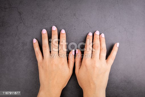 946930880istockphoto Woman's hands with neat manicure 1167911877