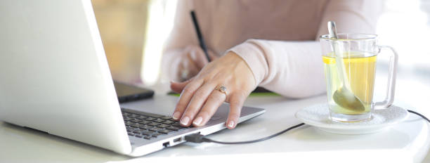 Woman's hands with pen, tablet and laptop stock images stock photo