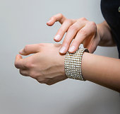 Woman's hands with shiny bracele