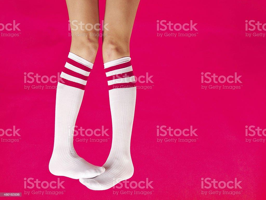 Woman's Hanging Legs Wearing Tube Socks stock photo
