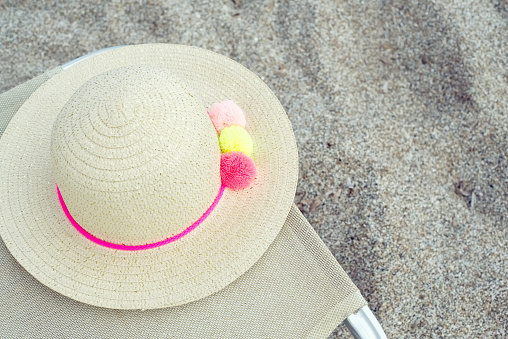 Woman's hat on a sun bed