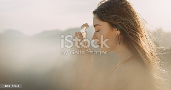 Woman on mountain, crystal healing