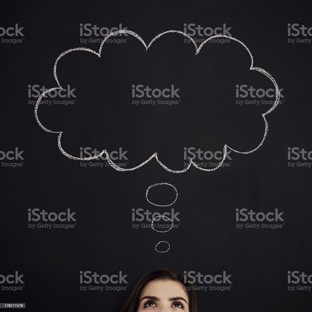 A woman's head with a thought bubble above it stock photo