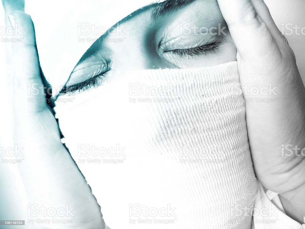 Woman's Head Wrapped in Bandages royalty-free stock photo